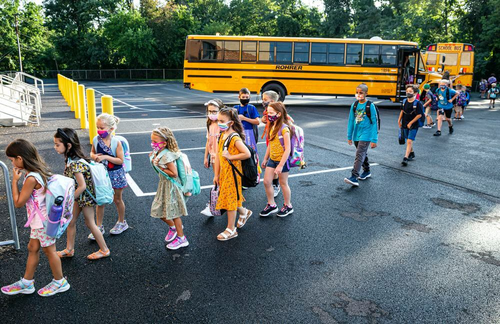 From The Bus Stop To After-School Activities, Here's How Kids Can Help Stay Safe During This Delta Variant Surge